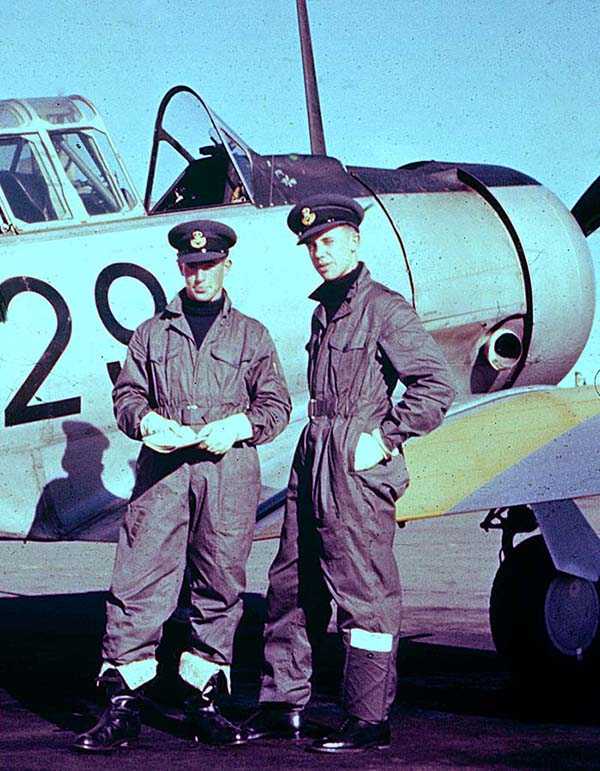 May 1957: Pete Blackgrove and me doing the war movie show-off beside our Harvard steed