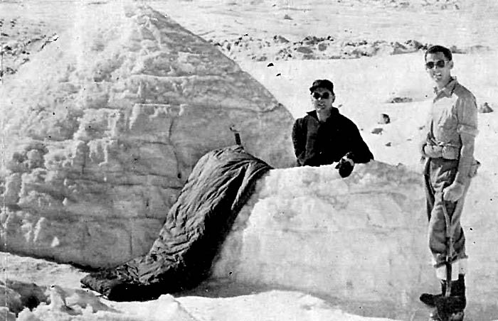 Tasman Glacier 1959: The completed igloo with Wally Tarr and Pete Rule residing.