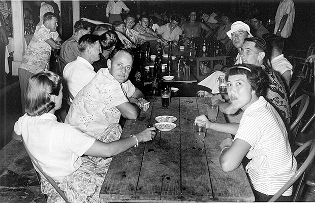 1960: A 41 Squadron happy hour at Telok Paku Leave Centre. Me in white hat.