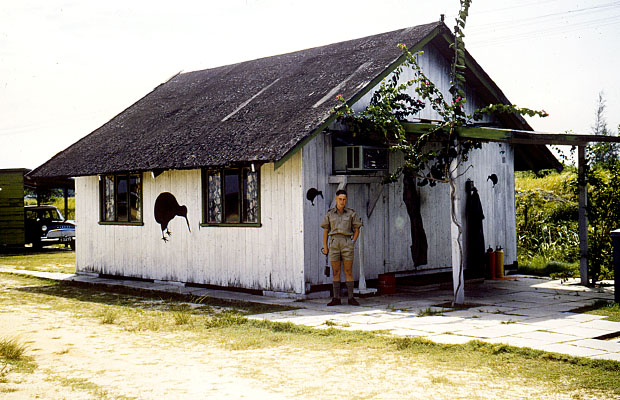 1960:  41 Squadron aircrew hut at RAF Changi with Ken Walker outside