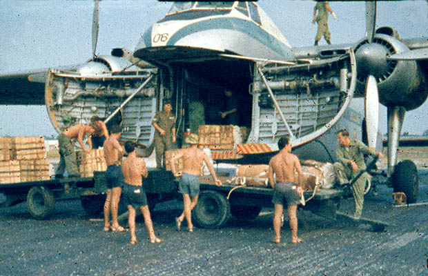 1965:  Loading for a Drop Mission over Sarawak.  Gordon Thompson on right