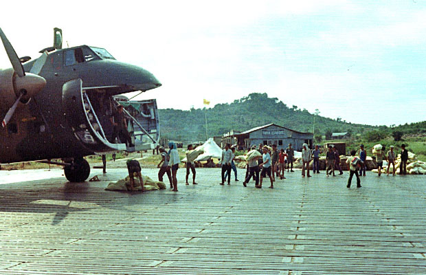 1975: 41 Squadron aircraft unloading at An Toi airfield, Vietnam