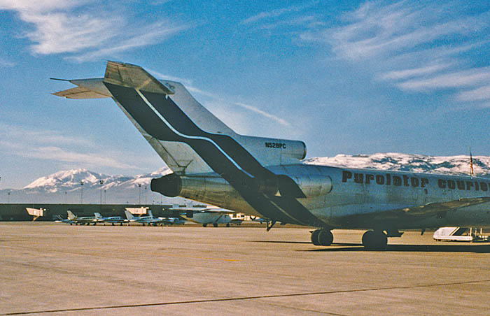 A Purolator Courier B727-100 at Reno, Nevada in early 1986. My home [now] is on the hills at the left.