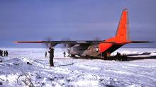 USN VX6 Hercules C-130 BL at the South Pole Station. Unloading with engines running. Elevation 10,000'.